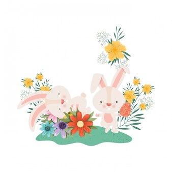 Coelhinhos da páscoa com ícone isolado de flores