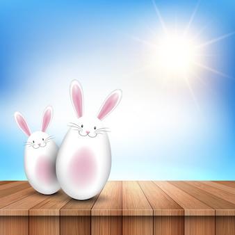 Coelhinhos da páscoa em uma mesa de madeira, olhando para um céu ensolarado