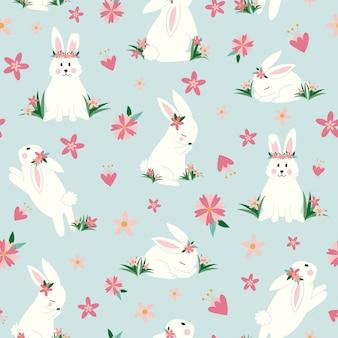 Coelhinhos fofos com flores sem costura padrão