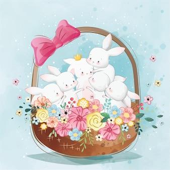 Coelhinhos fofos na cesta de primavera