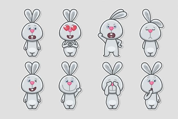 Coelho bonito dos desenhos animados com adesivo de emoções diferentes definido.