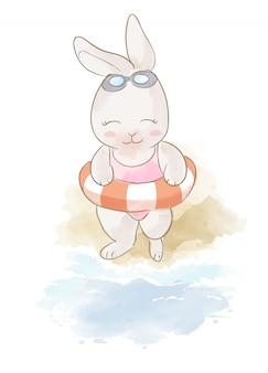 Coelho de desenho animado e anel de natação na praia