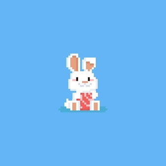 Coelho de páscoa de pixel com ovo de páscoa rosa