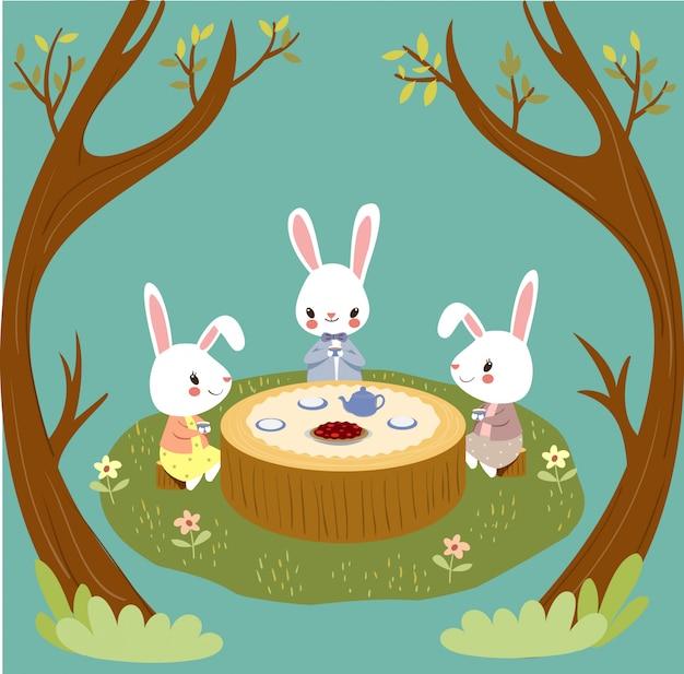 Coelhos bonitos desfrutar de festa do tempo do chá em bosques