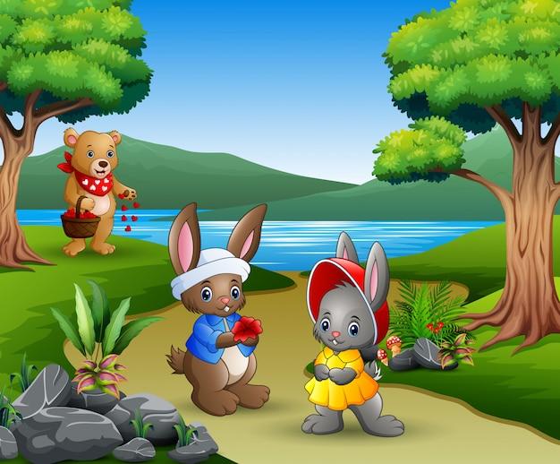 Coelhos de casal dos desenhos animados com a mãe ursos no parque