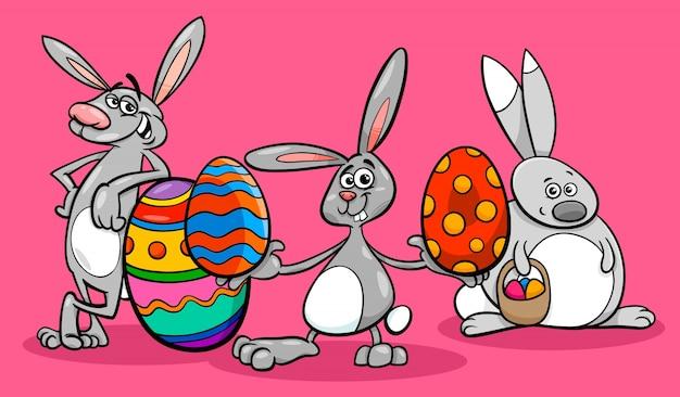 Coelhos e ovos de páscoa ilustração dos desenhos animados