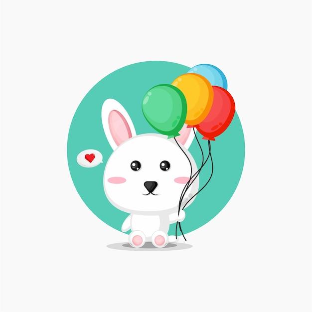 Coelhos fofos carregando balões coloridos
