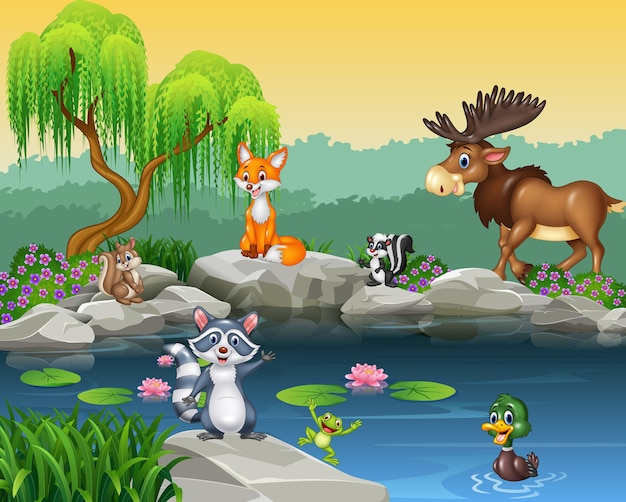 Coleção animal engraçado dos desenhos animados no fundo bonito da natureza
