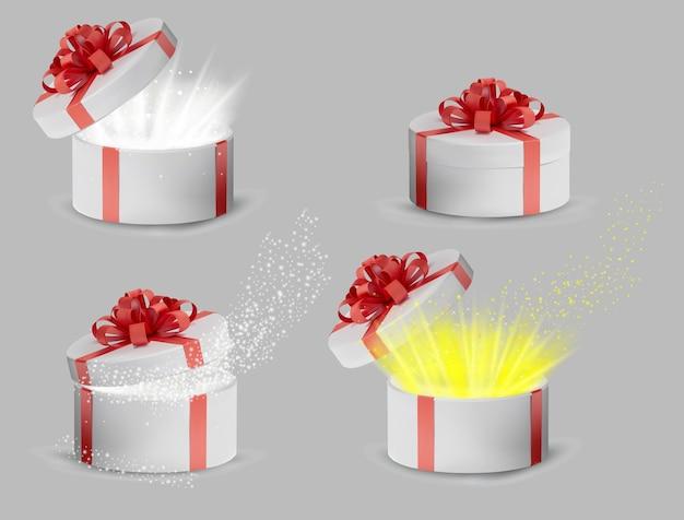 Coleção caixa de presente branca em uma fita vermelha e laço na parte superior. férias, caixa redonda de presente com brilhos no interior e raios de luz brilhantes. ilustração.