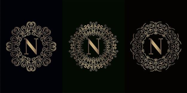 Coleção da inicial do logotipo n com moldura de ornamento de mandala de luxo