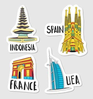 Coleção de adesivos coloridos desenhados à mão sobre os marcos do mundo
