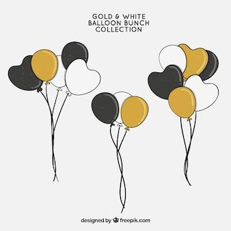 Coleção de bando de balões de ouro branco e preto