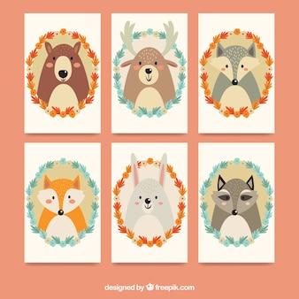 Coleção de cartões com animais e moldura floral