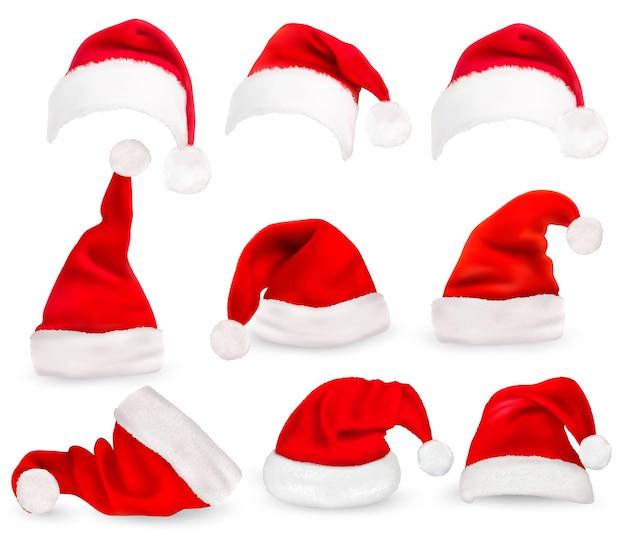Coleção de chapéus vermelhos de papai noel.