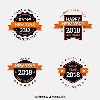 Coleção de crachás do ano novo de 2018 em laranja e preto