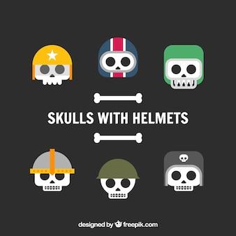 Coleção de crânios com capacetes em design plano