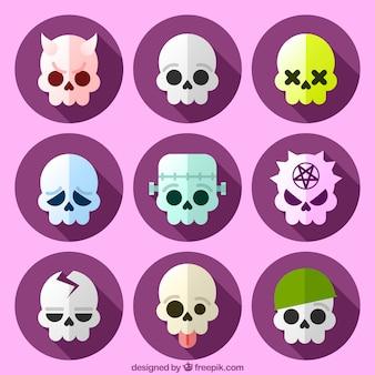 Coleção de crânios engraçados no design plano