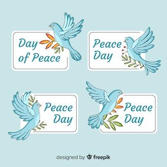 Coleção de distintivo de dia internacional da paz com pombas