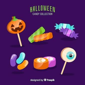 Coleção de doces de halloween no design plano