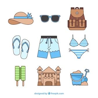 Coleção de elementos de praia com roupas na mão desenhada estilo