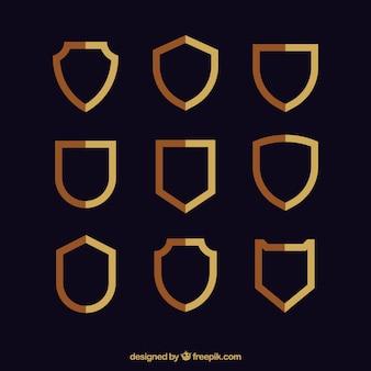 Coleção de escudos de ouro em design plano