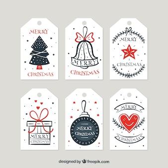 Coleção de etiquetas de natal desenhadas a mão retro