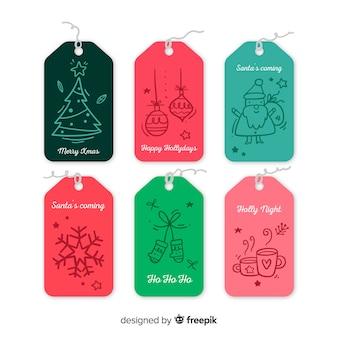 Coleção de etiquetas de natal mão desenhada estilo