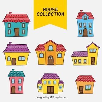 Coleção de fachadas desenhadas à mão de casas coloridas