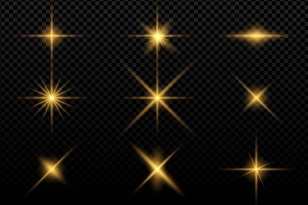 Coleção de flashes, luzes e faíscas. lâmpadas ópticas. abstratas luzes douradas isoladas