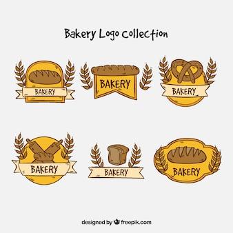 Coleção de logotipos de padaria em estilo desenhado a mão