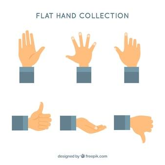 Coleção de mãos com poses diferentes em syle plana