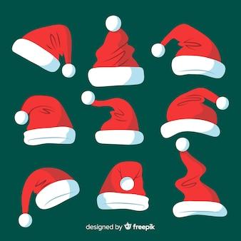 Coleção de natal de chapéu de papai noel em design plano