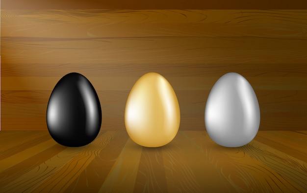 Coleção de ovos de ouro, prata e pretos em fundo de madeira. conjunto de ovos de páscoa em show room de madeira, conceito de investimento.