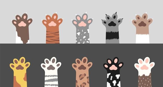 Coleção de patas fofas de gato. conjunto de silhuetas de pés de gatinho fofo.