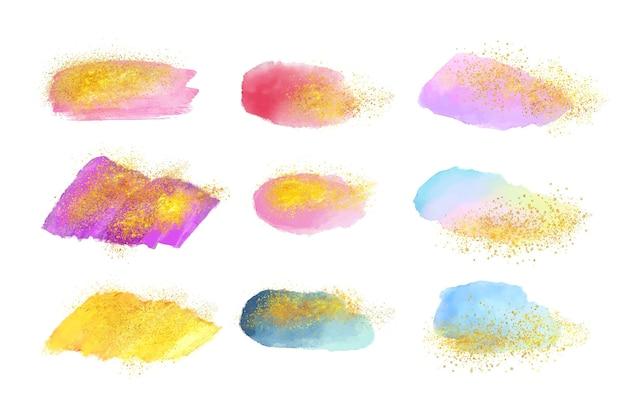 Coleção de pinceladas de aquarela pintadas à mão com ouro e glitter