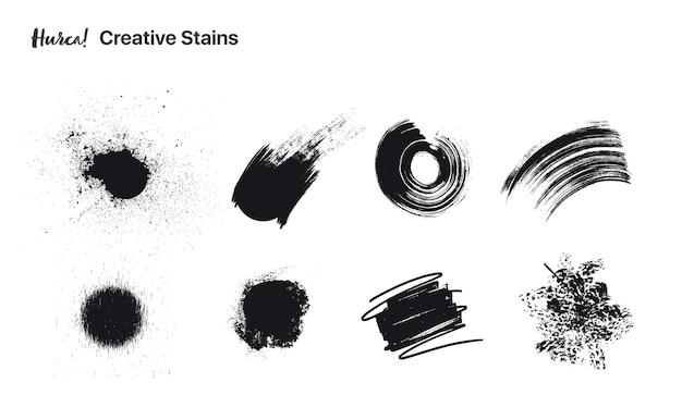 Coleção de pinceladas de tinta preta de diferentes formas feitas com pincel seco