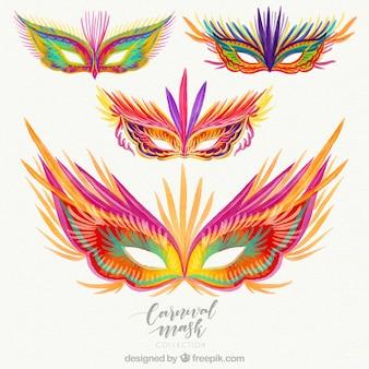 Coleção de quatro máscaras de carnaval desenhadas a mão