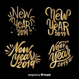 Coleção de rótulo de ano novo caligráfico dourado