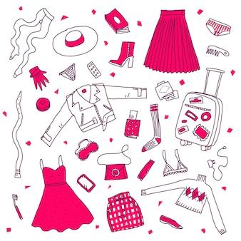 Coleção de roupas diferentes e coisas na bagagem