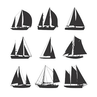 Coleção de silhuetas de veleiros.
