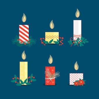 Coleção de velas de natal plana sobre fundo azul