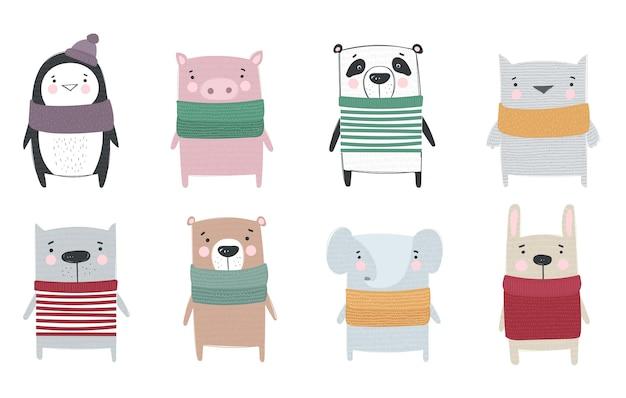 Coleção de vetores de desenhos de animais fofos de inverno em roupas aconchegantes. ilustração do doodle