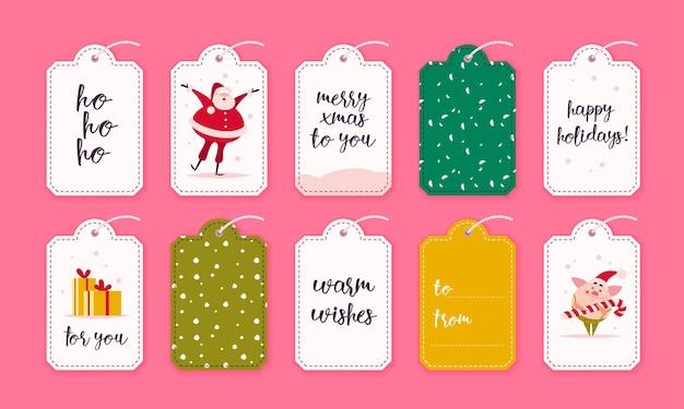 Coleção de vetores de etiquetas de presente de natal e emblemas isolados no fundo rosa. emblemas para o feriado de natal apresenta embalagens. padrão, local do texto, parabéns, design de personagens de ano novo.