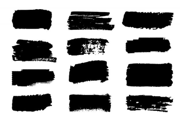 Coleção de vetores de traços de tinta. elemento pintado à mão abstrato de grunge. traços de preto e branco com um pincel.