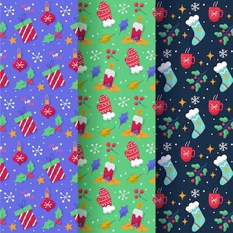 Coleção desenhada de padrões de natal