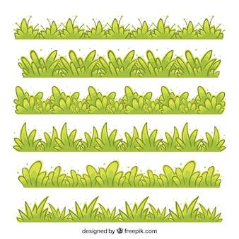 Coleção desenhado mão de fronteira grama em tons verdes