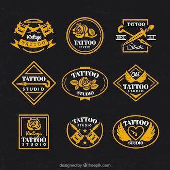 Coleção do logotipo do vintage para o estúdio de tatuagem
