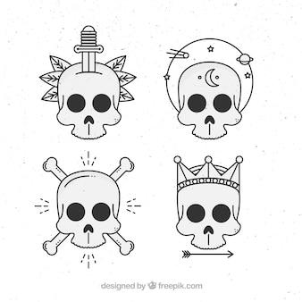 Coleção lisa de quatro crânios do vintage