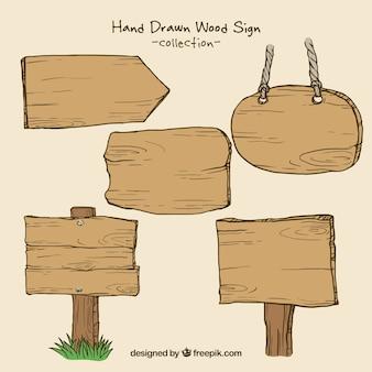 Coleção mão tirada sinais de madeira