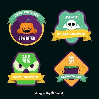 Coleção plana de etiqueta e distintivo de venda de halloween em fundo preto